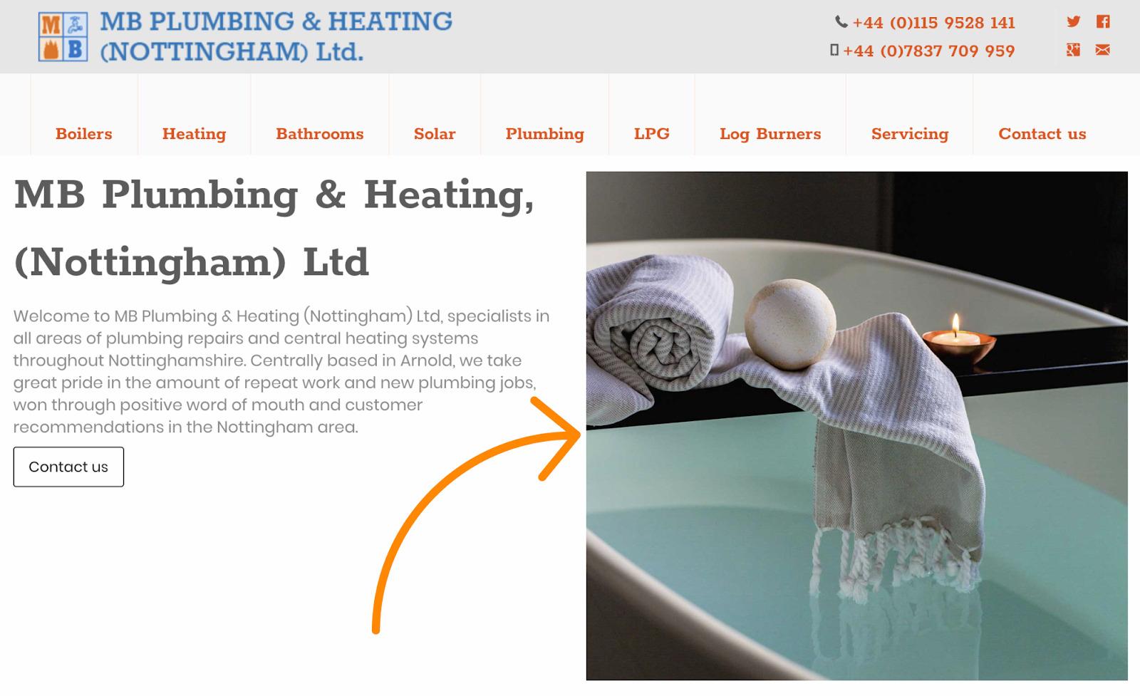 Fotografía de Stock de baño y velas en un sitio web de fontaneros
